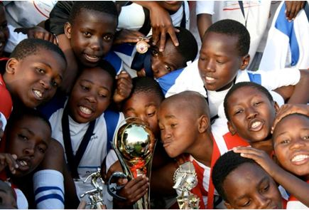 Children_celebrating_a_football_victory:a_Chance_to_Play