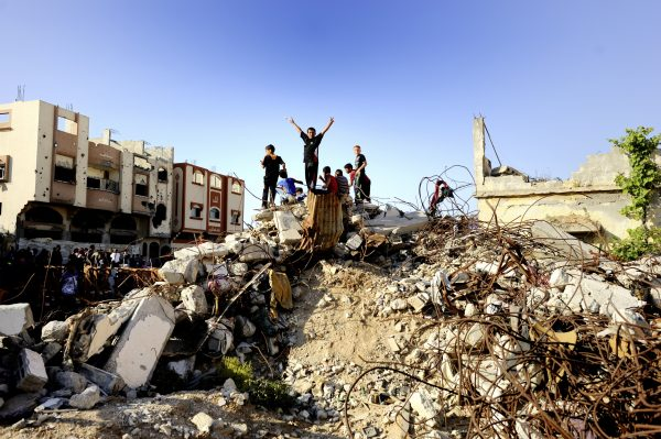 Gaza: Children playing in the rubbles of the Shuja'iyya neighborhood. The area has been severely damaged and partially destroyed by the summer 2014 shelling.
